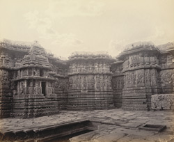 Views in Mysore. Ruined temple of Hallabeed [Hoysalesvara Temple, Halebid]. A section of western face
